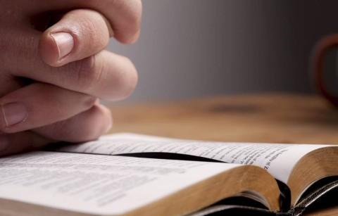 Praying over Bible